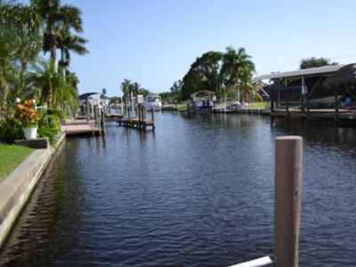 Photo for DIRECT GULF ACCESS, (NO BRIDGES) HEATED Screened Pool, NEW BOAT DOCK up to 28'