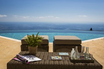 Heated infinity pool with spa jets and a view