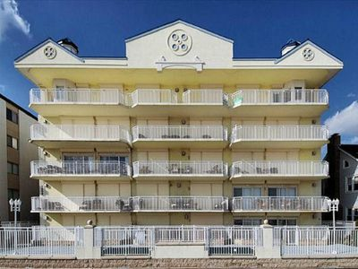 Photo for Oceanfront condo overlooking boardwalk, private pool, and steps to the beach