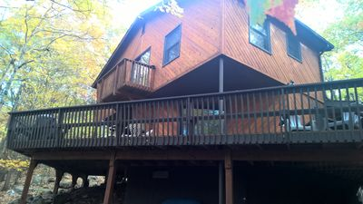 Outside - Side View - shows large deck with gas grill and balcony off of kitchen