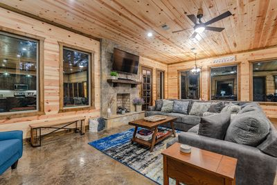 A spacious living room with a large comfy sectional couch accommodates many!