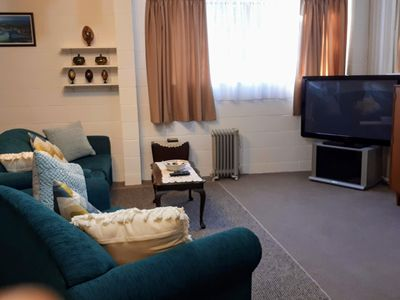 Lounge/living area with 2 single beds, Kitchen, cooking, continental breakfast .