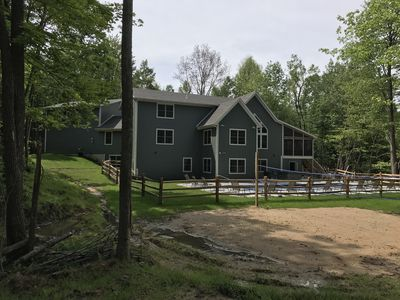 Sleeps 38! new home on 17 acres with pond, pool, volleyball court, trails