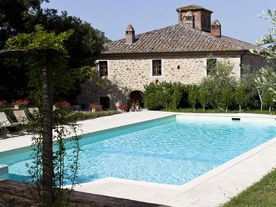 Villa Adalia: An elegant and welcoming apartment that covers the entire top floor of an ancient country manor built on a hillside, surrounded by meadows and woods.
