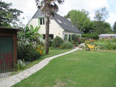 Photo for Large house of 185 m², terrace, large garden with trees and flowers bordered by a stream.