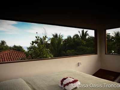 Photo for Tropical Treehouse loft with 360° mountain, jungle & beach views, & sandy beach