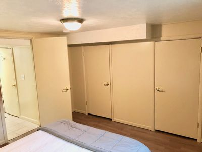 2 closets (1 with a dresser and 1 with space for hanging clothes)