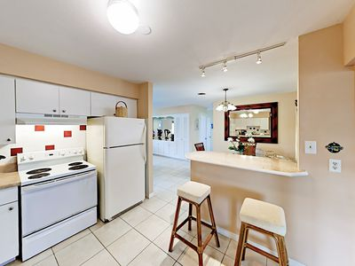 Kitchen - A breakfast bar provides additional seating.