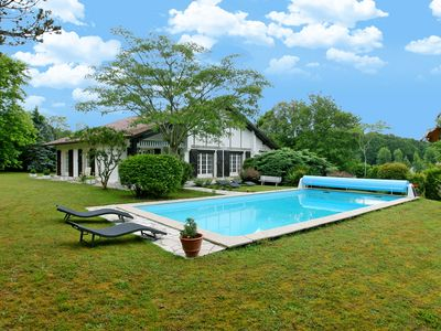 Photo for Experience this Basque Style Retreat with Charming Gardens and Heated Pool