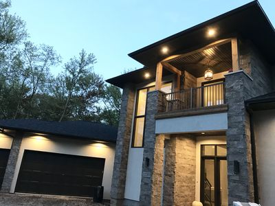 Photo for NEW Moden luxury retreat on wooded lot