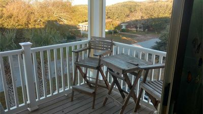 Photo for Adorable two bedroom beach condo with private beach, pool and hot tub