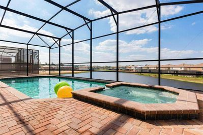 Screened heated pool and spa with lake view