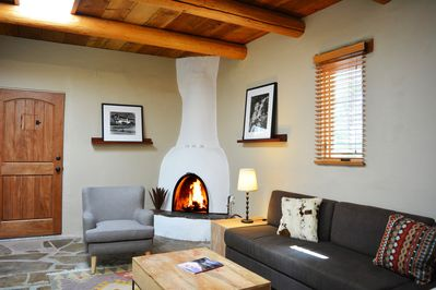 Wood burning kiva fireplace, slate floors, tall ceilings, light and bright ambiance
