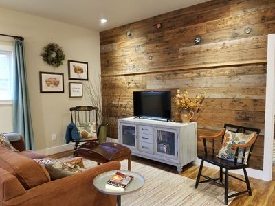 Our reclaimed wood wall makes the open concept room feel warm and welcoming.