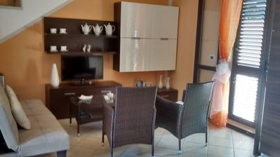 Photo for Just 250 meters from the beach, large and bright, air conditioned.