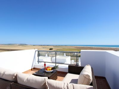 Photo for Modern townhouse with communal pool and great sea views