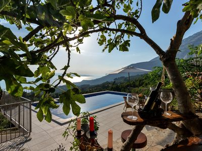 Photo for CHEAP!Charming stone house above Tučepi with pool, sea view, barbecue, wifi