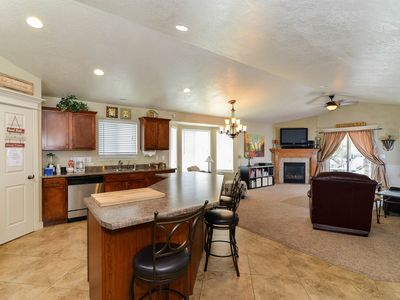 FAMILY ROOM OFF KITCHEN WITH SOFA, RECLINER, GAS FIREPLACE, FLATSCREEN TV