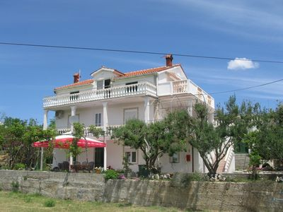 Photo for Holiday apartment with air conditioning, terrace and sea view