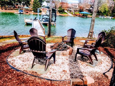 fire pit with seating for six overlooking the lake