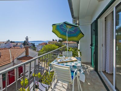 Photo for Cozy Apt with a sea-view balcony, quiet area, close to center of Hvar+parking