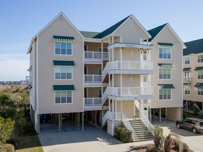 Photo for Vacation in this tranquil coastal condo minutes from the sand & sound of OIB!!