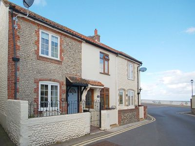 Photo for Cockleshell Cottage  - superb, traditional flint cottage in an enviable position yards from the sea.