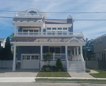 Photo for Simply beautiful new beachblock home with views of the ocean and a heated in-ground swimming pool.