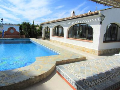 Pool view from covered pool dining terrace