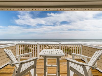 Photo for Updated beachfront condo with sweeping ocean views and plenty of room