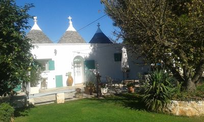Photo for Trulli in Valle d'Itria with pool and pinewood with hammocks ....... a fairy tale!