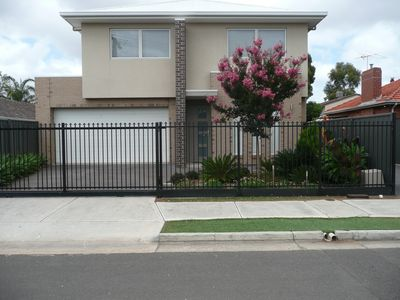 Front Entrance with secure remote sliding gate