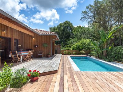 Photo for Wooden house with heated pool and view into forest