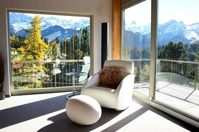 Lounge with fabulous south facing views with sliding doors onto 3 m wide balcony