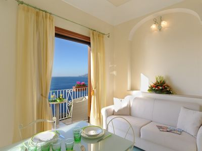 Photo for Green apartment, amazing view overlooking Positano village