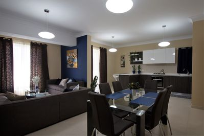 A very spacious open plan kitchen/dining/living area