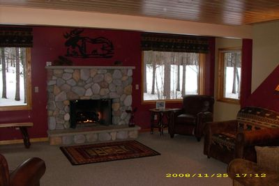Spacious Living Room with flatscreen TV, fireplace overlooking the golf course