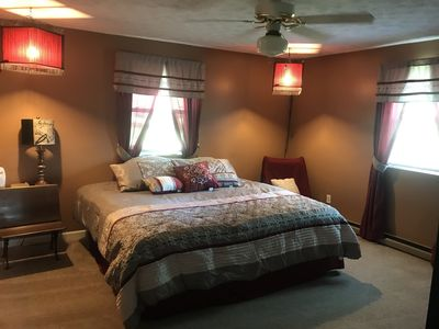 Master Bedroom with a King Size bed and large screen television.