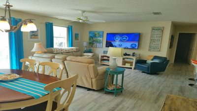 """Photo for Gas Golf Cart, WiFi, Leather Reclining Sofa, King Bed, 60"""" TV, CENTRAL Location"""