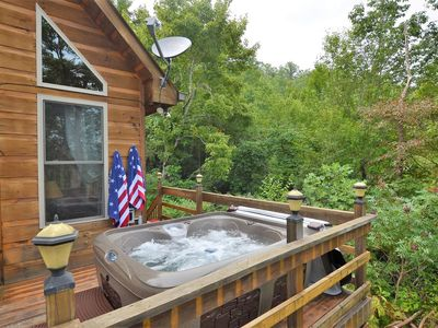 Photo for Beautiful, pet friendly secluded cabin with fire place and hot tub.