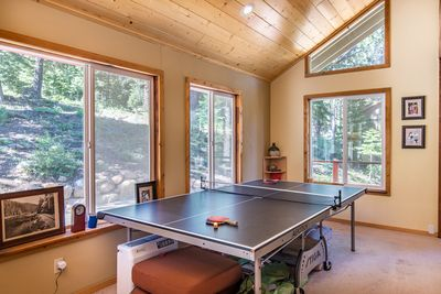Ping-Pong Table - Enjoy a friendly game of ping-pong in the well-lit living room.
