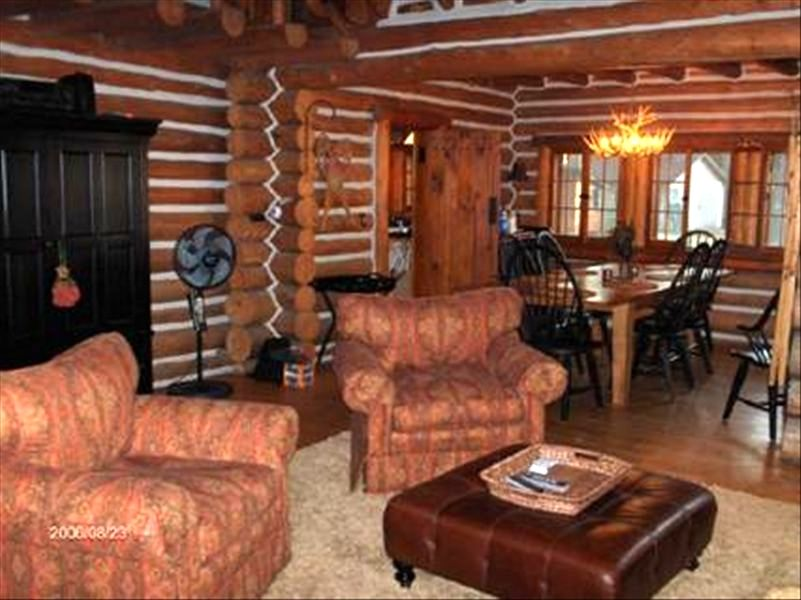 log cabin living room.  Torch Lake Majestic Log Cabin Living VRBO