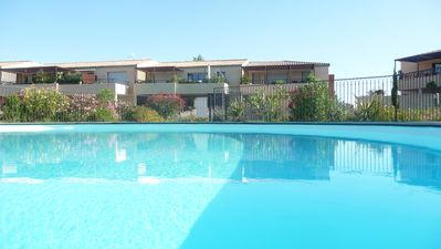 Photo for Aigues-Mortes apartment rental with pool + private parking