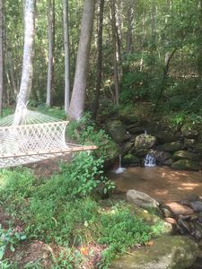 Lay back in the hammock and enjoy the sights and sounds of the stream.