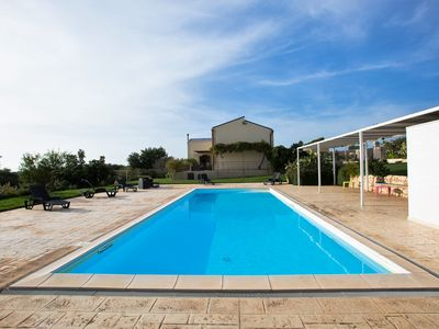Photo for Villa with panoramic views immersed in a fantastic garden with swimming pool.