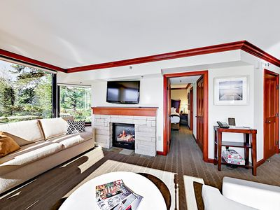 Living Room - After a fun-filled day on the mountain, unwind in the sunlit living room next to the gas fireplace.