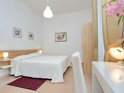 Photo for Bright two bedroom apartment, for up to four people, situated in an authentic Rome neighbourhood eas