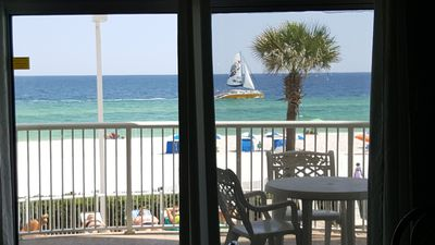 Photo for TradeWinds 102 - Beach Front condo with amazing sunsets and Gorgeous Views