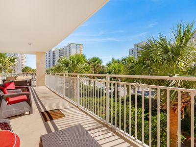 Photo for Beachfront romantic getaway with gulf view, private balcony and shared amenities