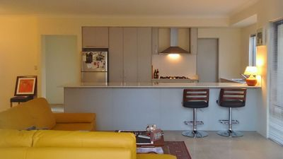 Photo for BRAND NEW, SPACIOUS HOME FOR 12 - SUPER CENTRAL LOCATION! 5 MINUTES TO AIRPORT